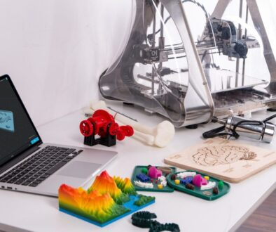 MacBook Pro beside 3D printer