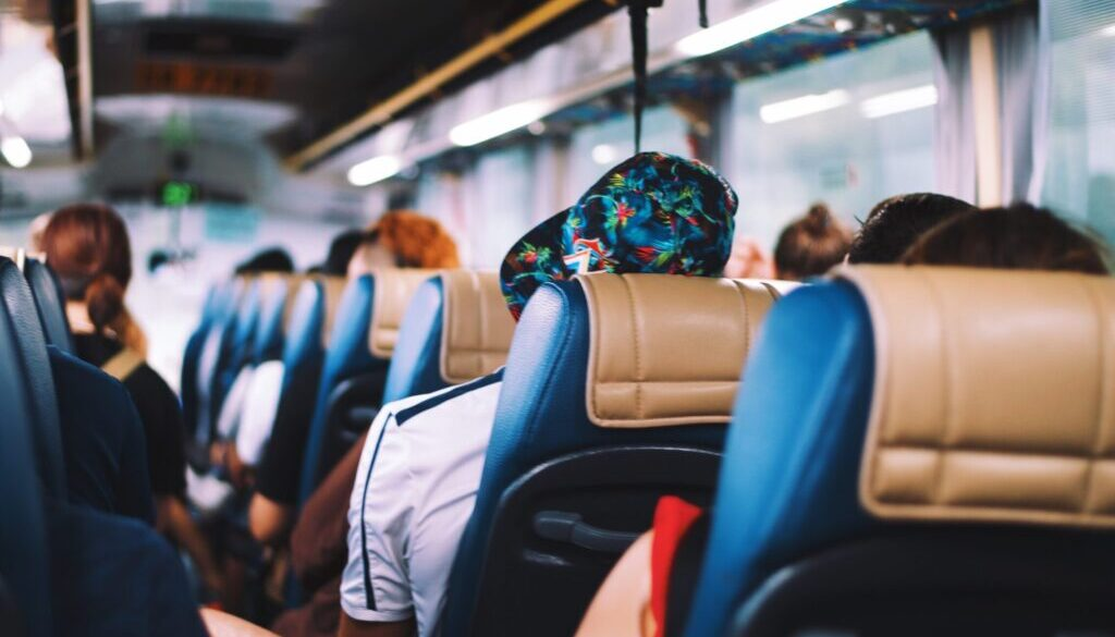 selective focus photography of people on bus