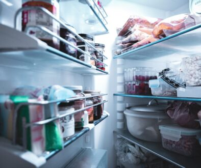 white refrigerator with assorted food